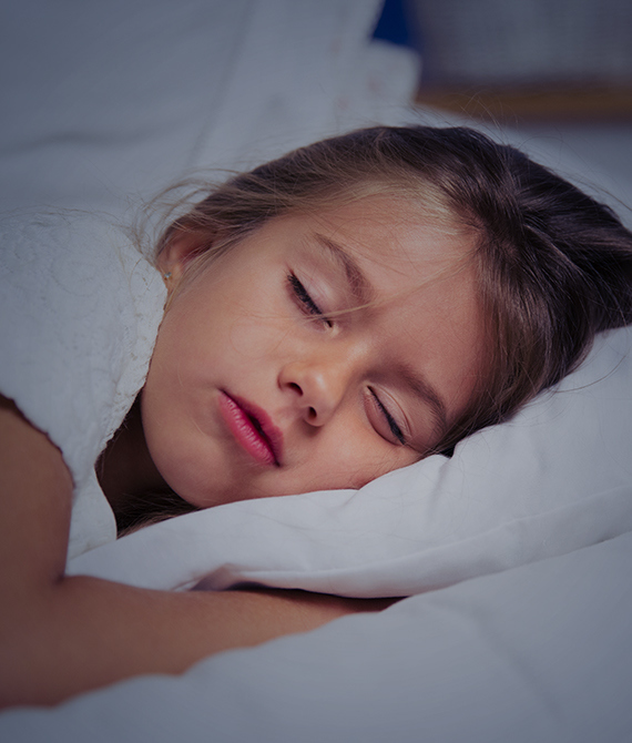 Young girl sleeping confortably